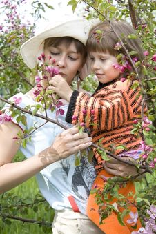 Mum And The Daughter With A Branch In Hands Stock Photos
