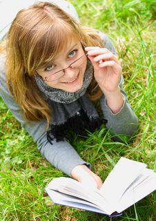 The Girl Reads The Book Stock Photo