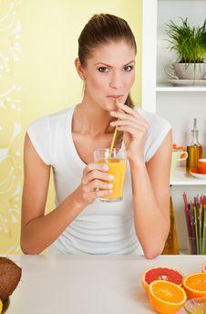 Free Beauty, Young Girl Drinking Orange Juice Stock Image - 14808611