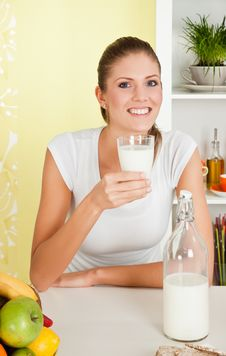 Beauty, Young Girl Holding A Glass Of Milk Royalty Free Stock Photography