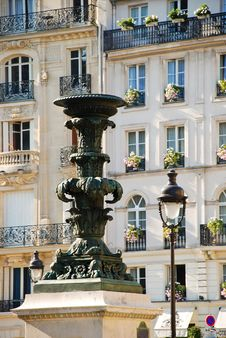 Fountain And Lantern Against The House Royalty Free Stock Photography