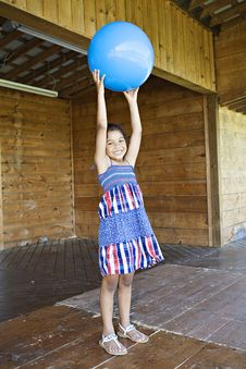 Free Little Girl Holding Up Ball Royalty Free Stock Images - 14811379