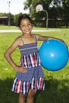 Free Little Girl Holding Blue Ball Royalty Free Stock Images - 14811629