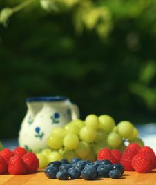 Fresh Blueberries, Raspberries And Grapes Stock Images