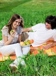 Girl With Fruit And Boy With Smile Royalty Free Stock Photo