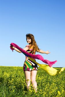 Free Girl On A Yellow Field With Handkerchiefs Royalty Free Stock Photos - 14817008
