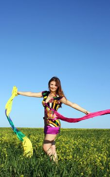 Free Girl On A Yellow Field With A Scarf Stock Image - 14817071