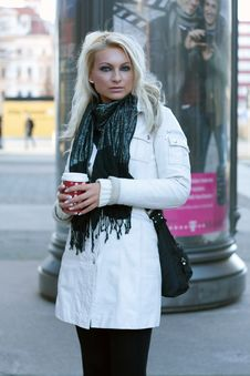 Free Young Blond Woman With Drinking Cup Royalty Free Stock Images - 14832449