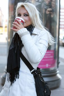 Free Young Blond Woman Drinks Out Of A Cup Stock Photography - 14832742