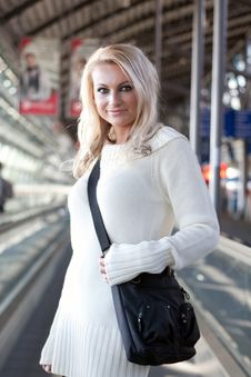 Young Blond Woman With Shoulder Bag Stock Image