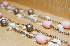 Free Bead Necklace On A Wooden Surface Royalty Free Stock Photos - 14836018