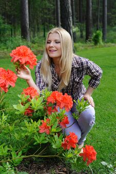 Free Beautiful Gardener Woman With Red Flower Bush Stock Images - 14840224