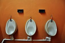 Urinals And Soap Holders Royalty Free Stock Photo