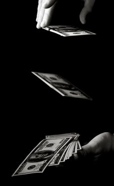 Hands With Dollars Over Black Royalty Free Stock Photo