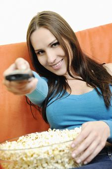 Free Young Woman Eat Popcorn On Orange Sofa Royalty Free Stock Image - 14845706
