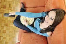 Free Young Woman Eat Popcorn On Orange Sofa Royalty Free Stock Photos - 14845708