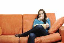 Free Young Woman Eat Popcorn On Orange Sofa Royalty Free Stock Photos - 14845728