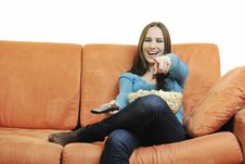 Free Young Woman Eat Popcorn On Orange Sofa Royalty Free Stock Photo - 14845735
