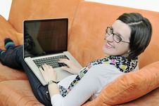 One Young Woman Working On Laptop Stock Photo