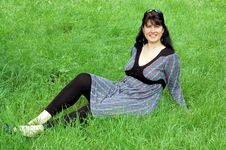 Free Beautiful Woman Relaxing In The Grass Royalty Free Stock Images - 14846829