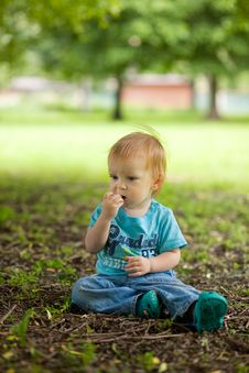 Free Cute Little Boy Sitting On The Ground Stock Photos - 14848133