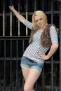 Free Blond Girl Posing Against Metal Gate Royalty Free Stock Images - 14858529
