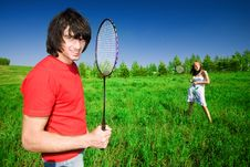 Girl And Boy With Rackets On Field Stock Images