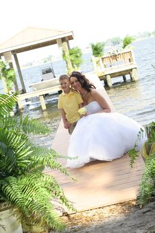 Beautiful Bride With Child On Dock Royalty Free Stock Photography