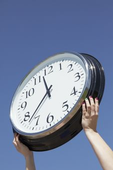 Free Hands Lifting Big Clock Outdoors Stock Images - 14852484