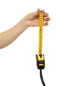 Tape-measure In A Beautiful Female Hand Stock Images