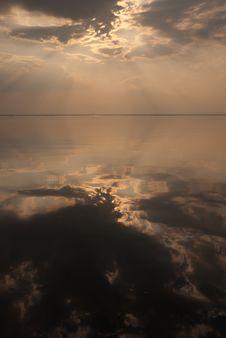 Reflection Of Evening Sky With Rainy Cloud Stock Photos