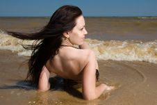 Free Young Woman Siitng Under Tidal Waves Royalty Free Stock Image - 14856236
