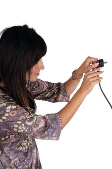 Free Woman Plugging Electric Cord Royalty Free Stock Photos - 14857838