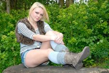 Pretty Blond Girl Relaxing On Log Royalty Free Stock Photos
