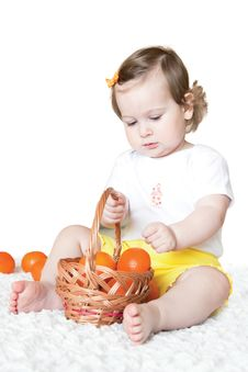 Free Little Girl With Tangerines Stock Photo - 14865420