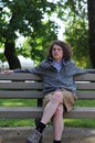 Free Teenager Sits On Bench And Relaxes Stock Photos - 14875103