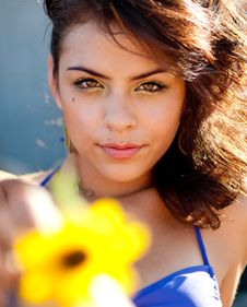 Free Young Woman Holding A Sunflower Stock Photography - 14874002