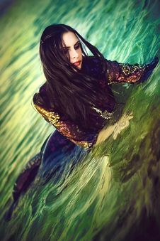 Portrait Of The Beautiful Brunette In The Sea Royalty Free Stock Image
