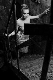 Free Beautiful Woman Standing On The Grungy Stairs Stock Images - 14875784