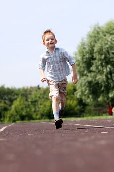 Free Boy Runs In A Summer Park Royalty Free Stock Photo - 14878345