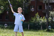 Free Boy Is Played With Soap Bubbles In The Street Stock Images - 14878404