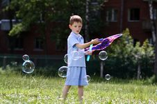 Free Boy Is Played With Soap Bubbles In The Street Royalty Free Stock Images - 14878409