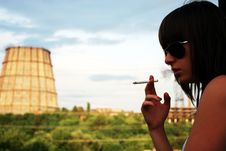 Portrait Of The Smoking Girl In Sunglasses Royalty Free Stock Images