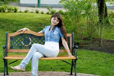 Free Girl Sitting On Bench Stock Images - 14879854