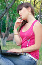 Free Young Beautiful Brunette Woman Using Her Notebook Royalty Free Stock Photography - 14889847