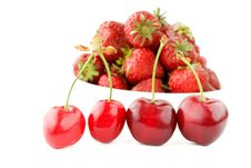 Ripe Cherry On Red Strawberry Background Royalty Free Stock Photos