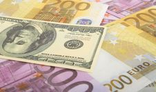 Dollar And Euro Bills Background Stock Photo