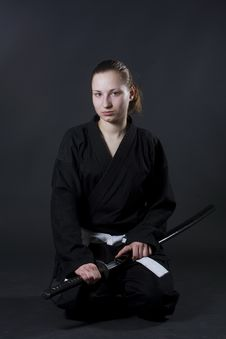 Female Samurai Holding Katana Stock Photos