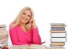 Portrait Of Young Smart Woman With Lots Of Books Royalty Free Stock Photography