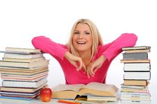 Young Student Girl With Lots Of Books Royalty Free Stock Photo